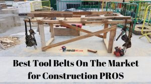 two of some of the best tool belts for construction professionals hanging on the corners of a carpenter's bench
