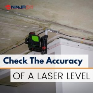 a laser level hanging on the ceiling whilst the builder is checking for its accuracy
