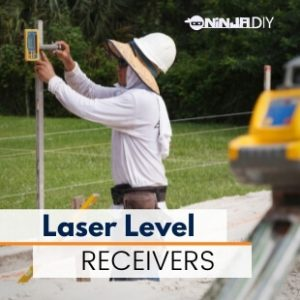 a construction worker using a laser level device and a laser level receiver to set up levels